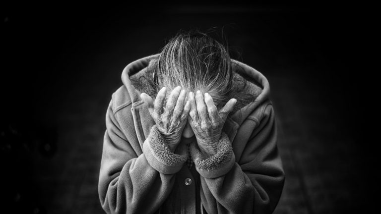 older woman showing grief
